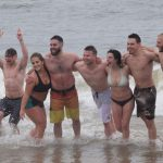 2018 Polar Bear Plunge participants standing in the surf