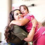 Woman hugs special needs student in school