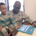 Parent Daren Gayle plays with autistic son DJ