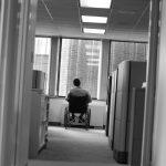 man in wheelchair in office