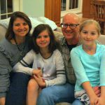 The Symons family pose for a photo in their Newark home.