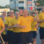 The Special Olympics Flame of Hope is carried along Route 1 in Rehoboth Beach