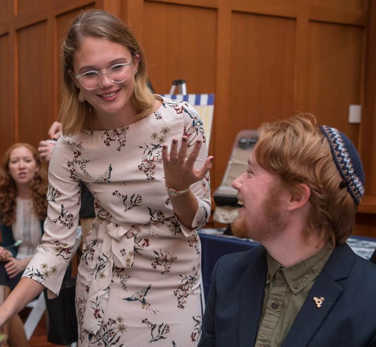 Finnigan Madison, a UD student with autism, speaks with Spectrum Scholars graduate assistant Kerry Pini (standing) at the Spectrum Scholars launch in September.