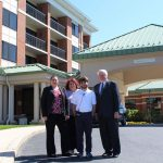 Rebecca Streets-Montagna, Donna Hopkins, Ian Snitch and Bill Sullivan pose in front of hotel where Ian was hired to work.