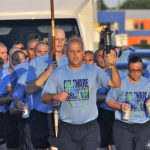 Mark W. Kristunas leads a group of police recruit runners as they accompany the torch