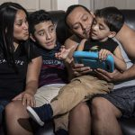 Velveth Roman Giron, left, and Pedro Marin Alvarez, with their children, Luis, 12, and Kevin, 5, at their home in Lancaster, Pennsylvania