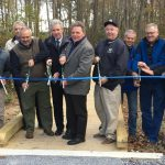 Cutting the ribbon for the Little Creek Wildlife Area boardwalk trail and wildlife-viewing tower east of Dover