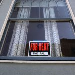 A For Rent sign in apartment window