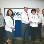 DFRC Executive Director Tony Glenn, far left, presents the foundations most recent donation to Kent-Sussex Industries Inc., with Ann Haggerty, KSI supported employment manager; B. Craig Crouch, KSI CEO; Marty McDonough, of DFRC; Jayson Crouch, KSI vice president; and Jim Greenwell, KSI comptroller.