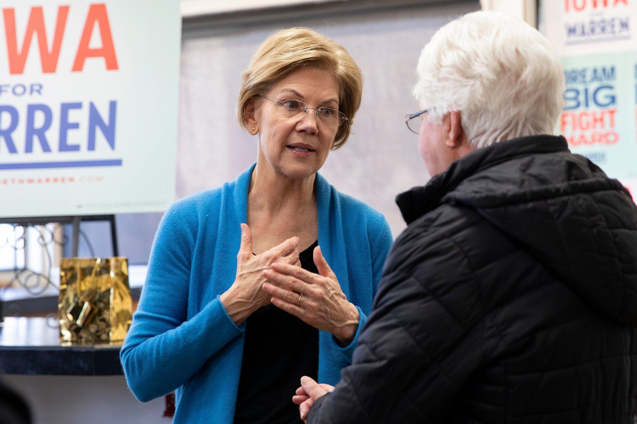 Senator Elizabeth Warren speaks to a potential voter