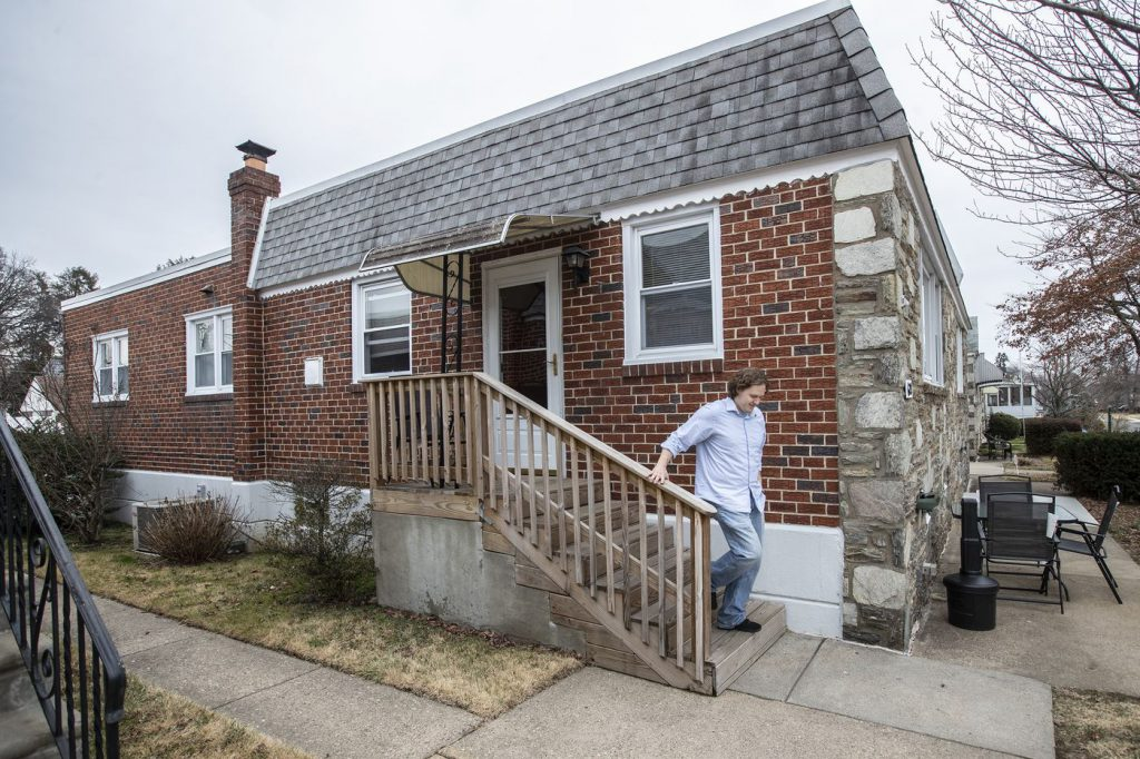 Josh Anderson, the assistant director of residential services at Resources of Human Development, leaves one of the residences the agency leases from Nestidd in the Fox Chase area of Philadelphia.
