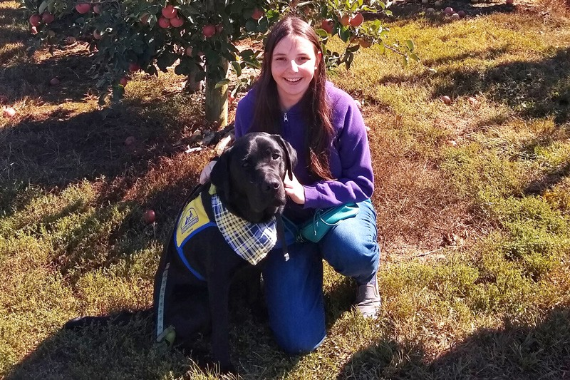 Lizzy Phillips is a first-year UD student in the Center for Disabilities Studies Career and Life Studies Certificate program and poses with a service animal