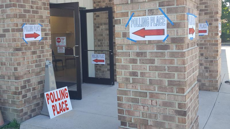 Outside a polling place in Delaware where signs direct voters to the voting booths