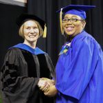 graduating student shaking hand of dean