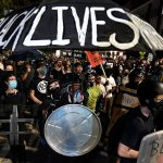 Protestors march in Rochester, New York in response to the police killing of Daniel Prude
